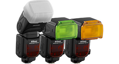 Photo of 3 Nikon Speedlight flashes, with color correction filters and a diffuser on them