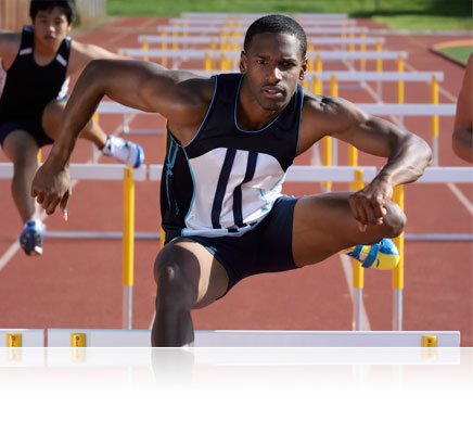 Nikon 1 V3 photo of a hurdler during a race, in air