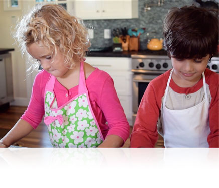 Nikon 1 J4 photo of a boy and girl baking in the kitchen