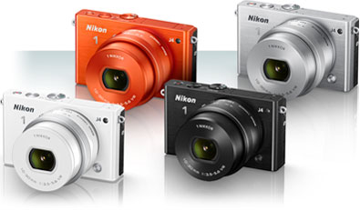 Grouping of four Nikon 1 J4 cameras, in orange, silver, white and black