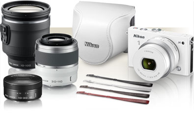 Photo of Nikon 1 accessories including a J4, three lenses, case and straps