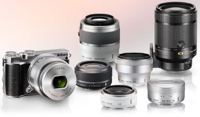 photo of the Nikon 1 J5 and a collection of six 1 NIKKOR lenses