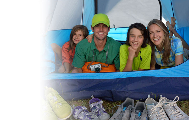 Photo of a family in a colorful tent with the Nikon 1 AW1 on a strap around the dad's neck