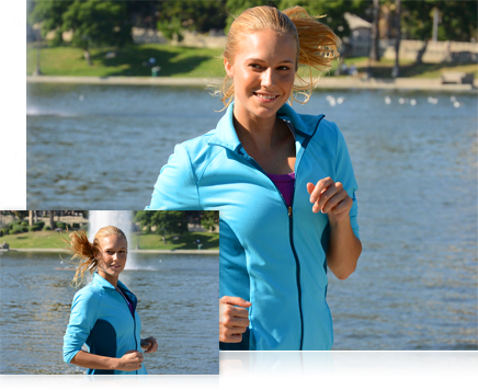 photos of a woman wearing a blue warm-up jacket, near a pond