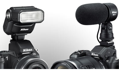 composite photo of the Nikon 1 V2 with accessories: SB-N7 Speedlight, GP-N100 GPS unit and ME-1 stereo mic