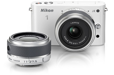 Photo of the Nikon 1 J2 and 1 NIKKOR 11-27.5mm f/3.5-5.6 lens in white