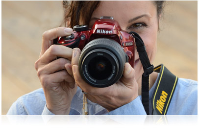Photo of woman holding Nikon D3200 HD-SLR