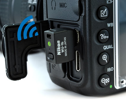 Close up product shot of the WU-1b wireless mobile adapter attached to the Nikon D610