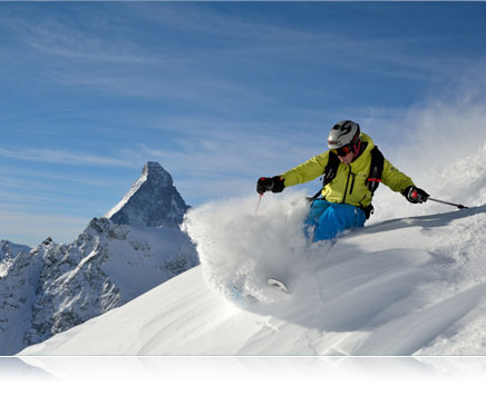 Photo of a skier going down a mountain in powder showing fast AF speed