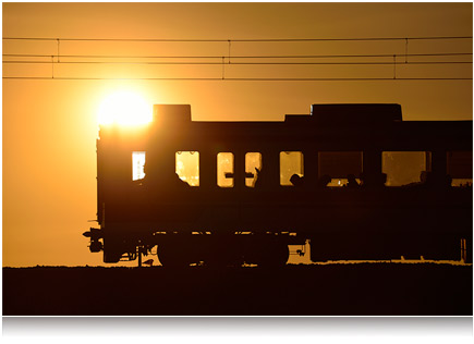 photo of a train silhouetted against an orange sky taken with the AF-S NIKKOR 80-400mm f/4.5-5.6G ED VR lens
