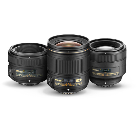 Nikon's collection of FX f/1.8 prime lenses, including the 28mm, 50mm and 85mm NIKKORs.