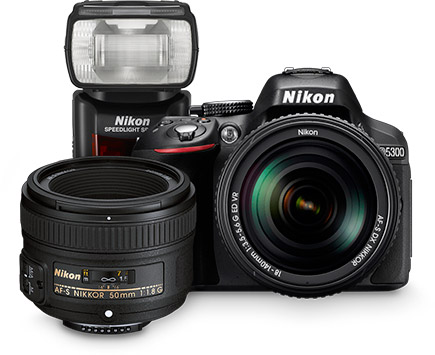 Photo of Nikon D5300 D-SLR with lens, additional lens and flash grouped together