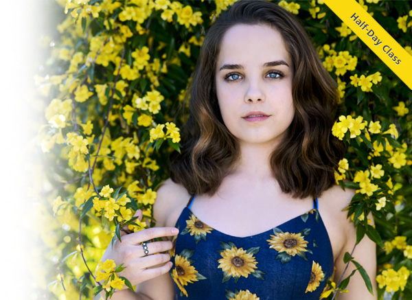 Photo of a young girl in front of sunflowers