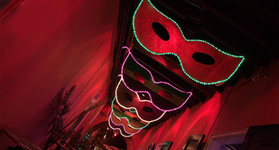 Photo of masks with a red hallway background