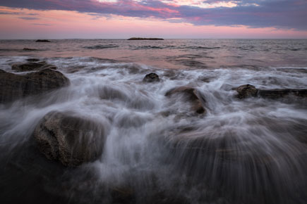 Adam Woodworth photo of crashing surf on rocks, taken in low light
