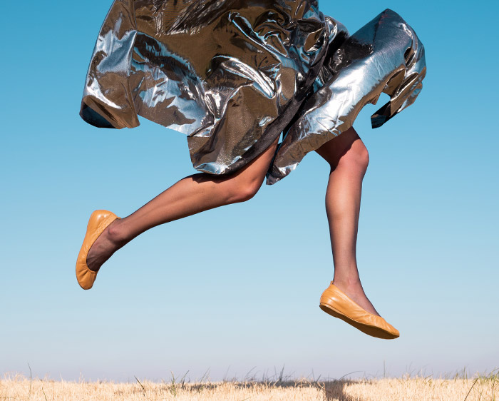 photo of a model's feet and skirt in the air, taken with the NIKKOR Z 40mm f/2 lens