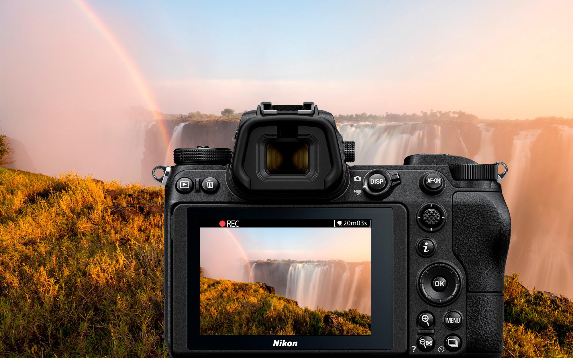 photo of a waterfall with a rainbow and a Z system camera in front of the scene with the same image on the LCD