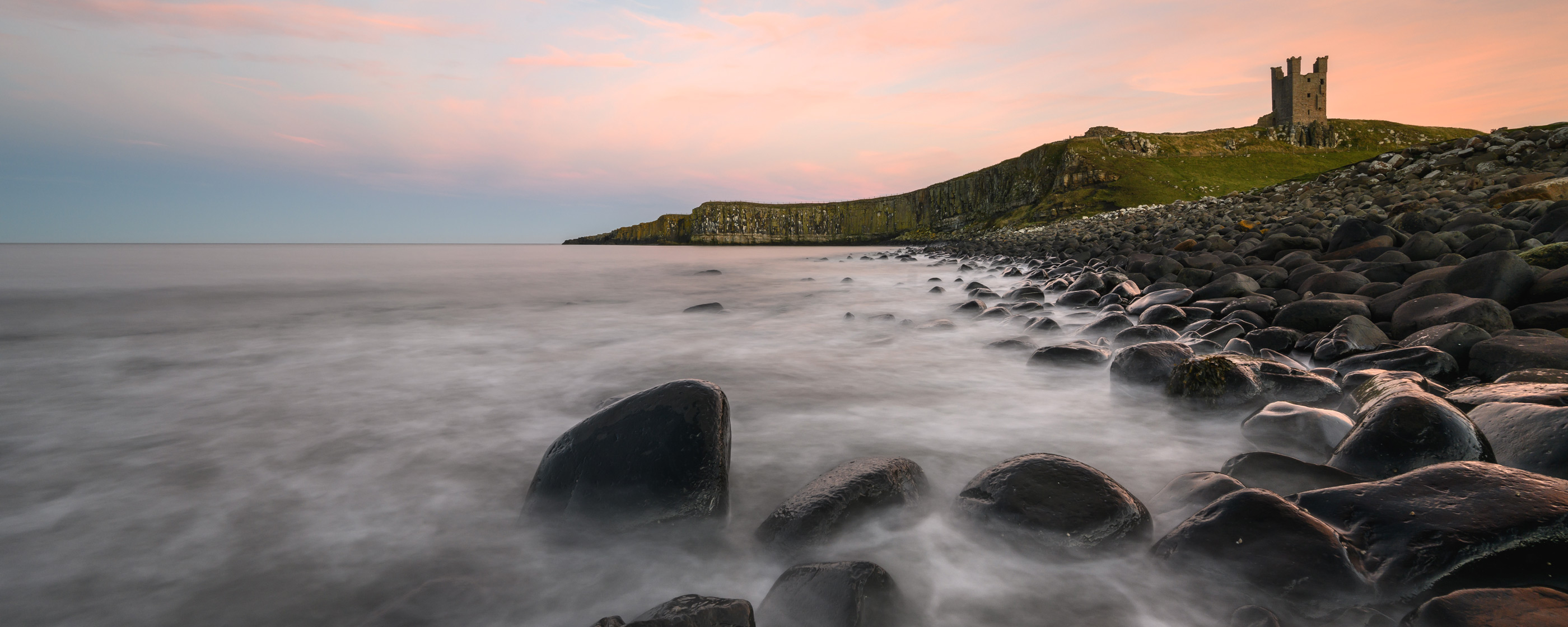 long exposure landscape photo with rocks, water and land, taken with the NIKKOR Z 14-30mm f/4 S