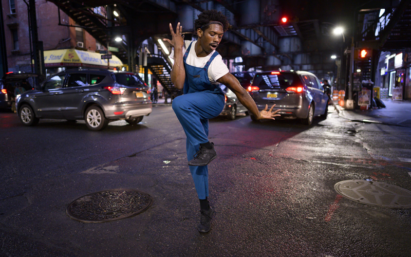 Image of man dancing at night on the street, taken with the NIKKOR Z 24mm f/1.8 S lens