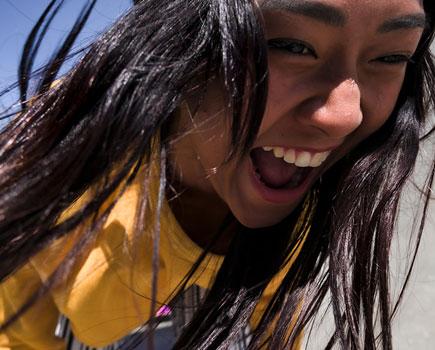 Z 50 and NIKKOR Z DX 16-50mm f/3.5-6.3 VR photo of a girl with long hair laughing