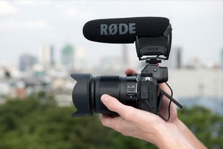 Photo of the Z 7 and NIKKOR Z 50mm f/1.8 S lens with a microphone on the hot-shoe