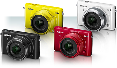 Photo of four Nikon 1 S2 cameras, in yellow, white, black and red