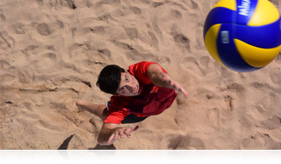 Nikon 1 V3 photo of a beach volleyball player spiking the ball