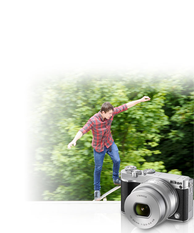 Nikon 1 J5 photo of a boy skateboarding inset with a product shot of the camera and 10-30mm lens