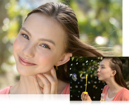 Photo of a girl in the park, close up with windswept hair, inset with a photo of her blowing bubbles