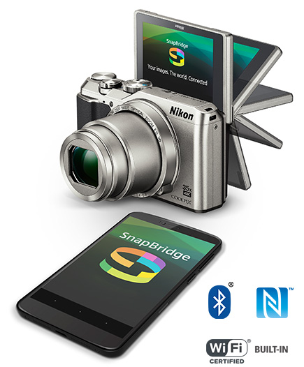 COOLPIX A900 showing the tilting monitor display and a smartphone with the SnapBridge logo