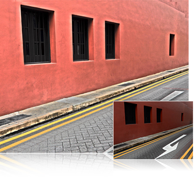 COOLPIX A900 photo of a red building and cobblestone street inset with the same image with creative exposure