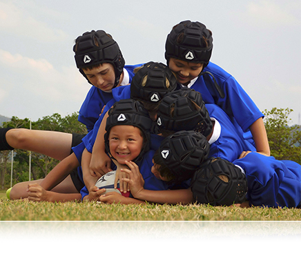COOLPIX B500 photo of 7 boys playing rugby piled on the ball