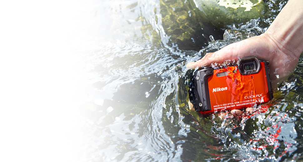 Photo of the COOLPIX W300 in a person's hand, in water