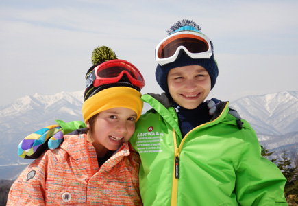 Photo of a boy and girl in winter jackets on a mountain, shot with the W300