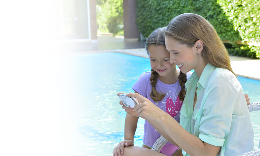Photo of a mom and daughter near a pool with the COOLPIX W100