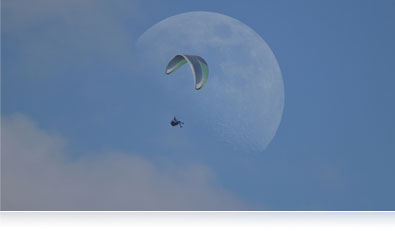 Photo of the moon and a glider highlighting the multiple exposure mode of the P600