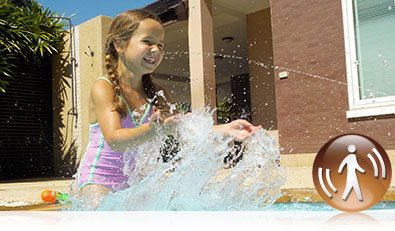 COOLPIX S33 photo of a girl splashing in a pool and the Motion Detection icon