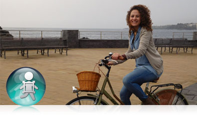 COOLPIX S7000 photo of a woman on a bicycle with the icon for Subject Tracking inset