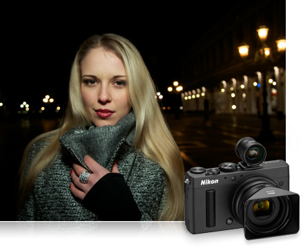 photo of a blonde woman in a sweater taken at night outdoors with a product shot of the Nikon COOLPIX A inset