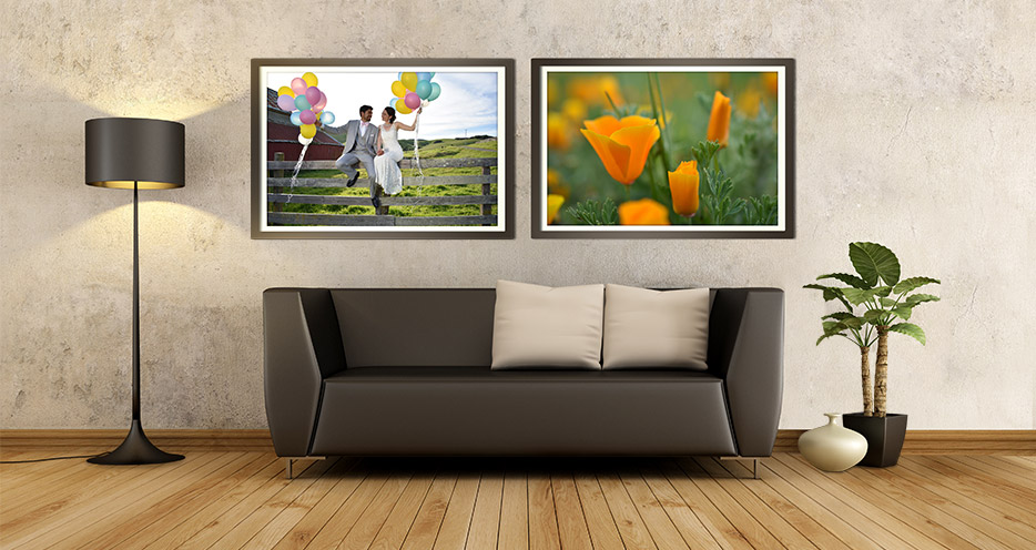 Photo of a living room with a picture of the bride and groom on the wall next to a photo of orange poppies