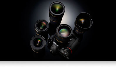 Photo of Nikon D5 surrounded by NIKKOR lenses
