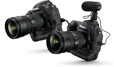 Photo of the D5 with a NIKKOR lens and ME-1 mic on the hotshoe, alongside a D5 with NIKKOR lens and Ethernet cable attached