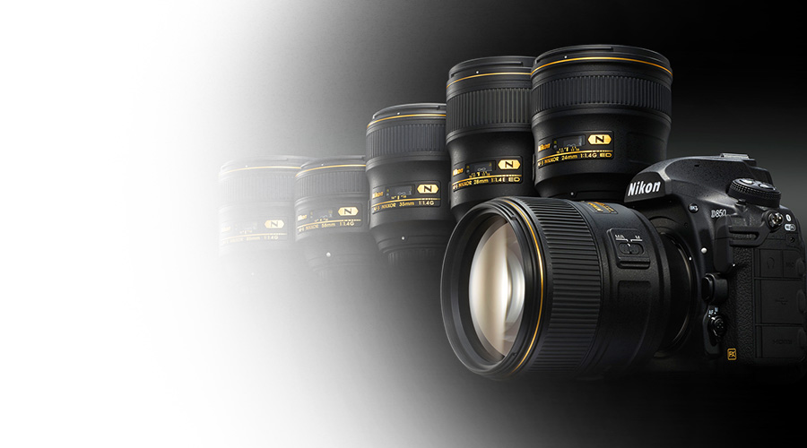 Product photo of the D850 DSLR and five NIKKOR lenses