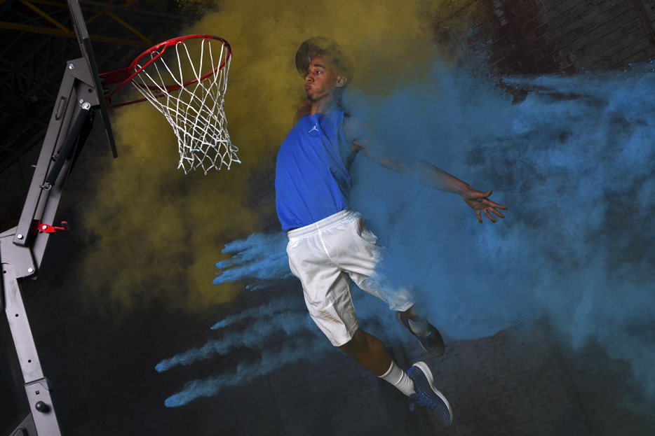 D850 DSLR photo of a basketball player dunking the ball