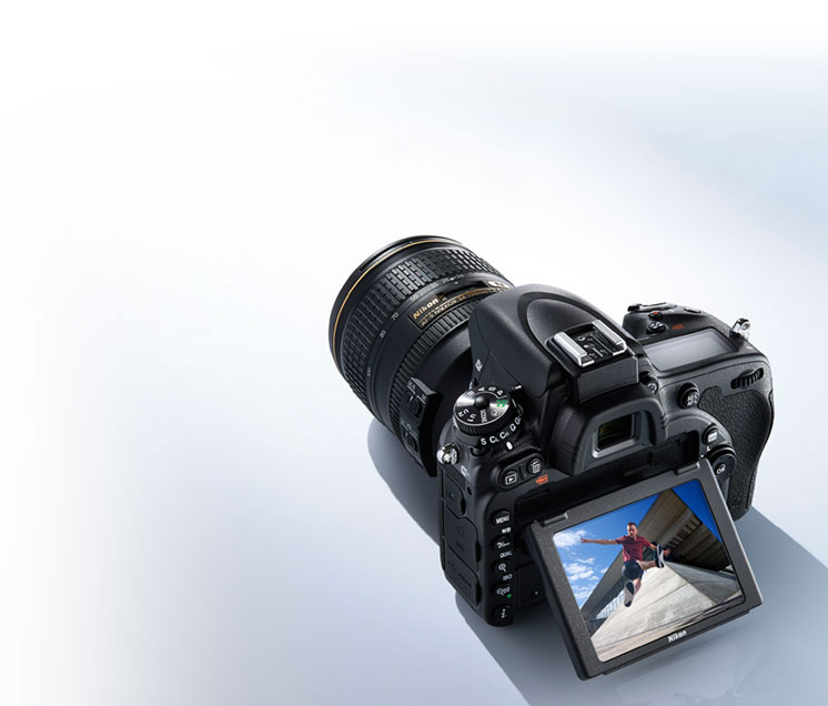 Photo of the D750 DSLR with NIKKOR lens and image of a parkour jumper on the LCD