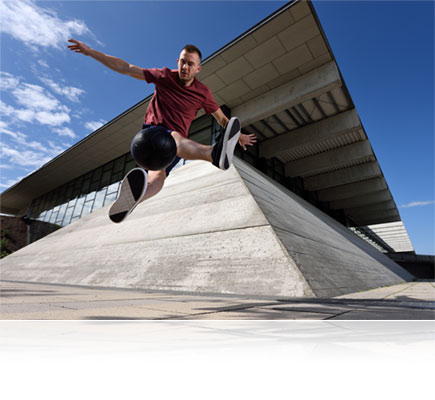 Nikon D750 photo of a male parkour athlete in mid air jump