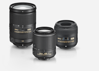 Product shot of three NIKKOR lenses