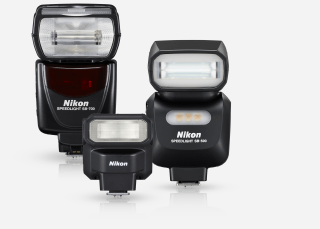 Product shot of three Nikon Speedlight flashes