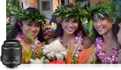 Photo of three hula girls in Hawaii and a product shot of the 18-55mm lens