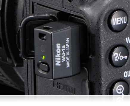 Nikon D7100 side of body close up with WU-1a wireless mobile adapter in place